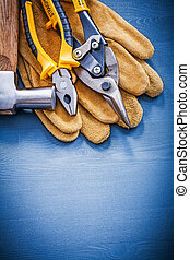 Variety of tools for repairing on wooden board copyspace