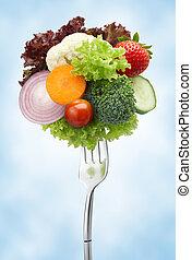 variety of vegetables on fork