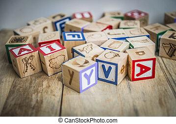 Variety wooden blocks on wooden floor1