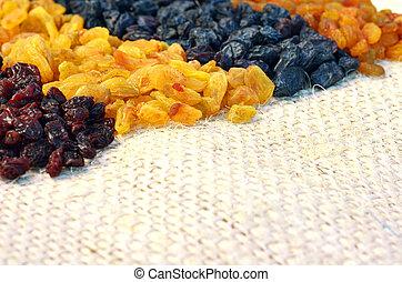 Various assorted raisins background