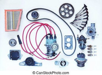 Various automobile spare parts lie over light background