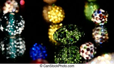 Various beads isolated on black background, close up