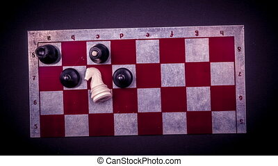 Various board games and figurines over checkers board