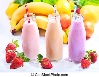 bottles of smoothie with fresh fruits