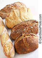 Various breads - Assorted kinds of fresh baked bread in a...