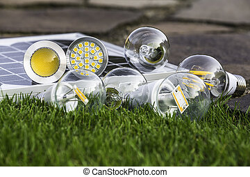 various bulbs E27, GU10 and solar panel on the grass - E27...