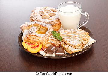 Various cakes and milk breakfast