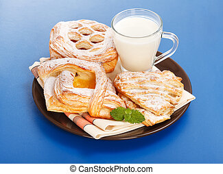 Various cakes and milk breakfast