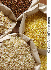 Various cereals in bags - Brown rice, oatmeal, millet and ...