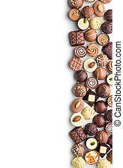 various chocolate pralines on white background