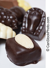 various chocolates candeis on white background - sweet food