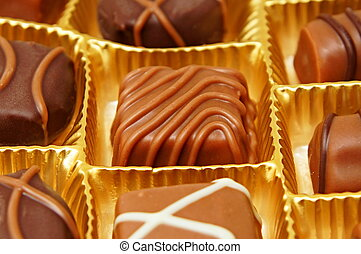 Various chocolates candies in a box