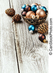 Various Christmas balls on wooden background