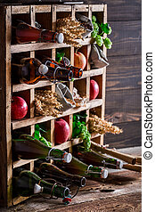 Various cider beer ingredients in old wooden box