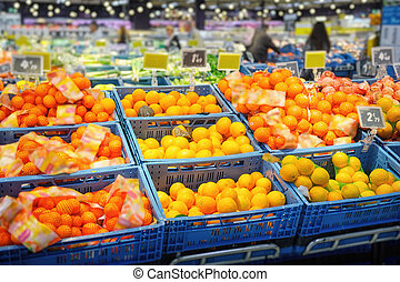 Various citrus fruits in supermarket