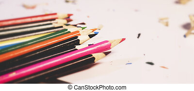 Various Color of Wooden Pencils Corner View on a Pure White Background.Sorted Colorful Pencils with Selective Focus on Subject.Blurry Background Heap of Colorful Pencils with Copy Space For Text .