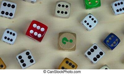 Various colorful dice. Gambling concept. Rotating turntable counterclockwise shot. 4K