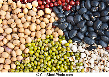 Various colorful dried legumes beans as background