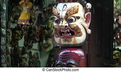 various colorful nepalese masks souvenirs in Kathmandu shop,...