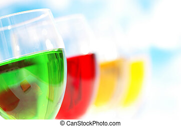 Various colourful cocktails against the blue sky