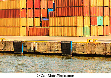 Various containers waiting in port. Cargo goods in harbour....