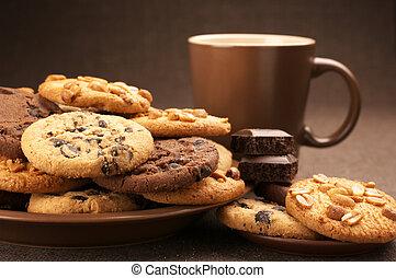 Various cookies and coffee - Assorted cookies in brown plate...