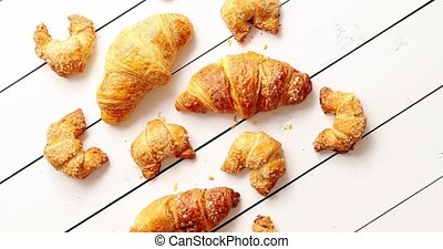 Various croissants lying on table - From above shot of set...