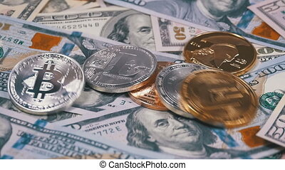 Various Crypto Coins Fall on the Table with Bills of US Dollars and Rotate. Slow Motion