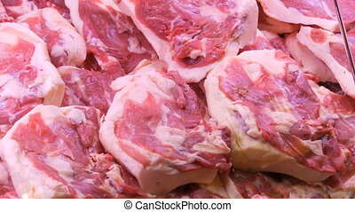 Various cuts of meat on the counter of butcher shop -...