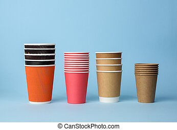 various disposable paper cup on blue background, rejection of plastic