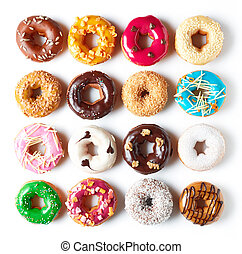 Various donuts isolated on white, from above