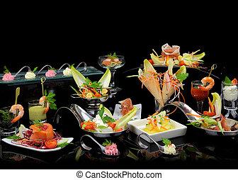 Various elegant gourmet dishes on black background