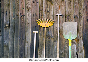 farmers tools on old wooden wall