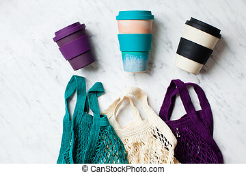 Various fashion colours of net bags and reusable coffee cups...