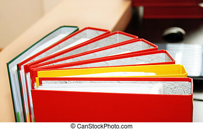 Various files - colorful files with documents on office desk...