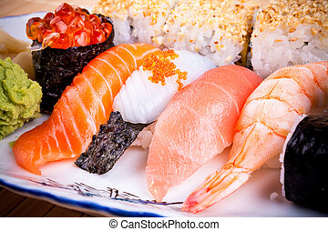 Various fish sushi with salmon ikura, close up