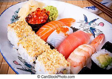 Various fish sushi with salmon ikura, top view