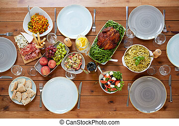 various food on served wooden table