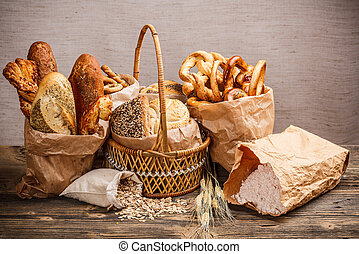 Various fresh baked goods with a basket, oat flakes and a...
