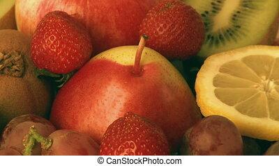 Various fresh fruit - Rotating pile of various fresh fruit,...