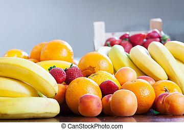 various fresh fruits at table