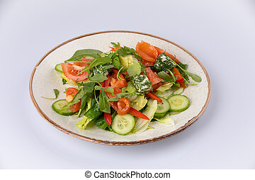 Various fresh mix salad with salmon, tomato, cucumber, onion, bell pepper, healthy food and diet menu.