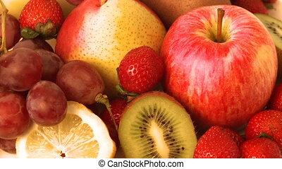 Various fruit   - Various fruit turning around