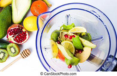 Various fruits in a blender for making a smoothie