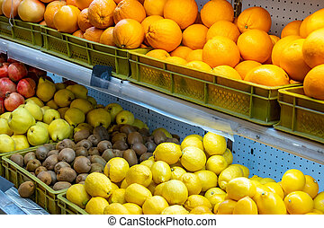 Various fruits in the market for sale.