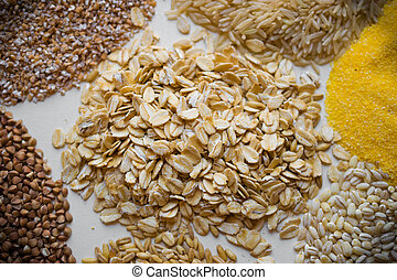 various groats and cereals as background