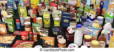 Various grocery products closeup, on black background with...