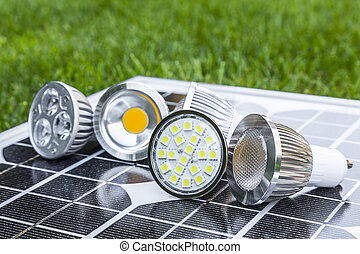 various GU10 LED bulbs on photovoltaics in the grass E27 LED...