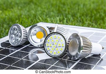 various GU10 LED bulbs on photovoltaics in the grass E27 LED...