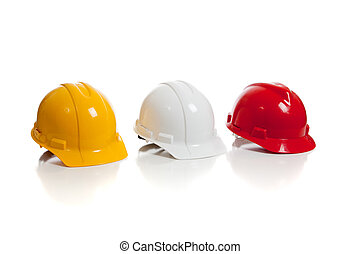 Various hard hats on a white background - A yellow, white...